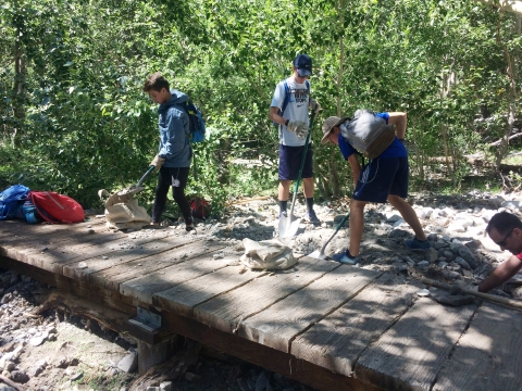 boy scouts shovel rocks at boardwalk convict lake