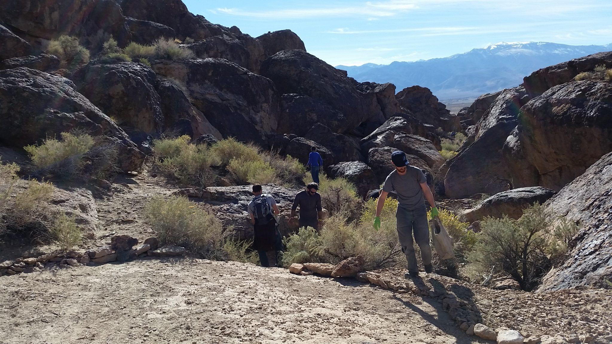volunteers table lands carrying rocks