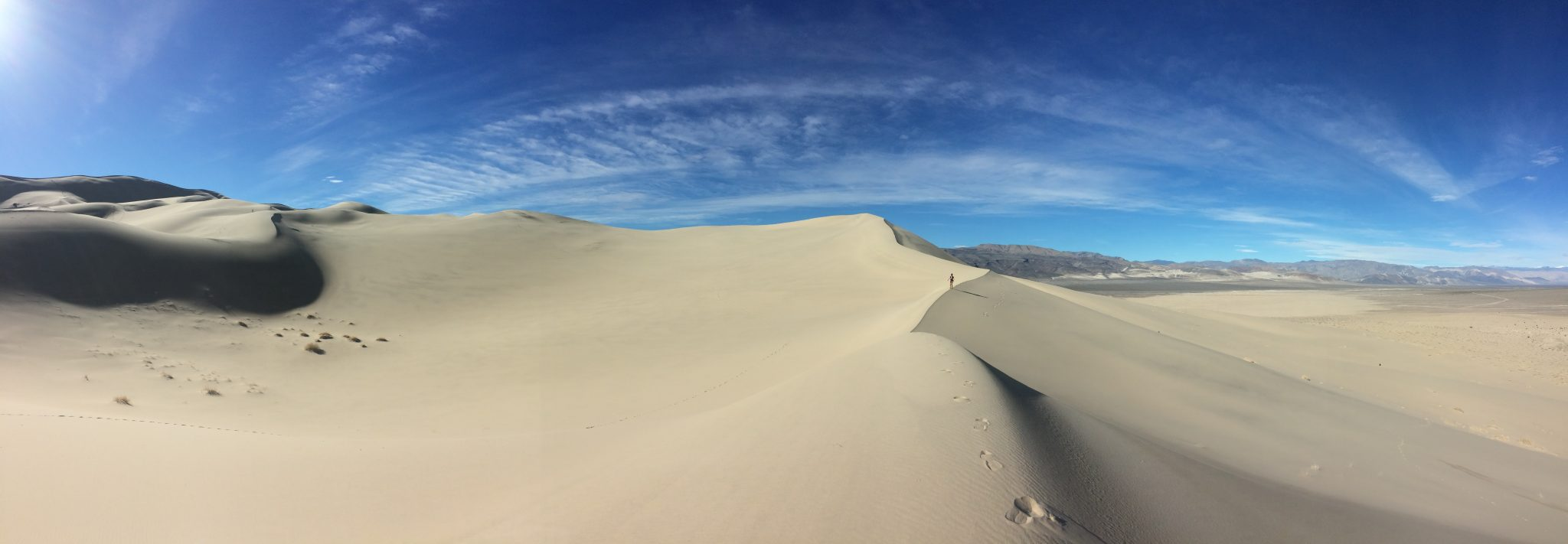 Eureka Dunes death valley with hiker
