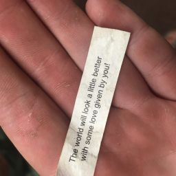 fortune note in hand